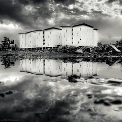 Storm Day (Le***Refs *PHOTOGRAPHIE*) Tags: bw white storm black reflection water modern clouds construction nikon day pluie nb explore reflet nuages frontpage hdr immeuble batiment flaque d90 lerefs