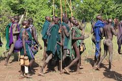 Leaving the battle field (martien van asseldonk) Tags: martienvanasseldonk ethiopia surma surmi donga stickfighting