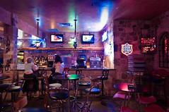 Oasis Bar (christian.senger) Tags: travel blue light people urban woman usa black bar night digital america reflections geotagged restaurant nikon neon glow texas purple availablelight decoration indoors chrome laketravis lightroom d300 christian_senger:year=2010 foursquare:venue=524243 osm:way=30830478