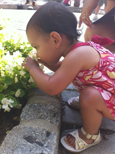 Laila smelling flowers