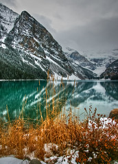 Winter Descending on Lake Louise (hflowers) Tags: winter mountain lake canada mountains landscape rockies alberta rockymountains lakelouise banffnationalpark canadianrockies mountvictoria victoriaglacier glaciallake fairviewmountain
