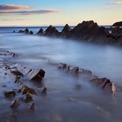 Fife Coastline (ajnabeee) Tags: ocean longexposure blue sea seascape motion blur beach water clouds river coast scotland rocks waves fife framed scottish 11 pebbles forth shore lee waterblur squarecrop rugged foreground firthofforth eastneuk 10stop nd1000 nd10 bigstopper shahbazmajeed