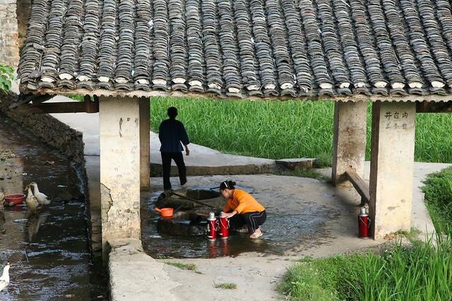 Woman drawing water, Chengyang, Guangxi, China
