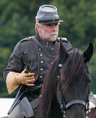Sheffield Fayre_300810_1900 (Steve Bark) Tags: park uk england horse war uniform sheffield norfolk confederate civil american pistol revolver rider reenactment fayre cavalry reenactor copyrightstevebark