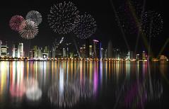 Happy Eid Doha (MJ ♛) Tags: light sea reflection tower night canon happy fire eos lights towers eid celebration works 1855mm celebrate efs doha qatar 2010 cornish برج عيد ابراج منظر الكورنيش قطر الدوحة الفطر احتفال كورنيش دوحة 40d ليلي احتفالات