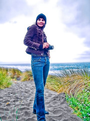 Portrait of Veronica at the Beach (Walker Dukes) Tags: ocean sanfrancisco california camera blue sky woman black cold green wool water beautiful grass fog clouds sand long waves purple legs boots wind path dunes jeans jacket cap tall topaz brisk corderoy whitecaps outset topazadjust