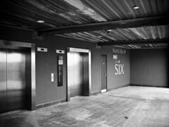 Six. (Tris1972 (tmorphewimages.co.uk)) Tags: cambridge bw geotagged lumix elevator panasonic g1 lifts grandarcade