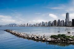 Metropolis (paulgalbraith) Tags: sea brazil beach brasil rocks apartments cityscape skyscrapers metropolis hotels santacatarina balneariocamboriu
