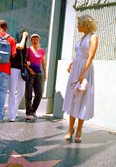 Hollywood Boulevard #1 (stillsguy) Tags: street light summer bw woman white stars high pretty dress kodak marilynmonroe crowd profile well sidewalk socal purse blonde heels konica hollywoodblvd af stores angular portra slender impersonator hexar 400vc wishers hollywoodchapter