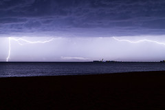 Over the Horizon (Chreriksen) Tags: ocean sea espaa lighthouse storm water night pier andaluca spain horizon electricity thunderstorm lightning rayo cdiz thunder intensesky findeverano
