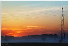 misty and... electric sunrise (Jeff BOVE) Tags: sunset sky mist clouds sunrise haze mood steel pylon jura franchecomt mt pylne baverans abigfave flickrdiamond brevans nikond300s