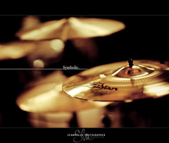 Symbolic. (Sean Molin Photography) Tags: bronze drums shiny photographer dof drumset bokeh 85mm depthoffield instrument cymbals zildjian musicstore guitarstore drumstore project85 seanmolin crashcymbol ridecymbol httpwwwseanmolincom eightyfiveofeightyfive projecteightyfivedaybyday