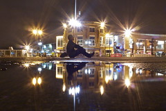 euro stars (maybemaq) Tags: uk light portrait man reflection water rain silhouette wales night circle puddle bay seaside europe sitting colours waterfront eurostar britain geometry euro cymru cardiff symmetry caerdydd wharf midnight transparent cardiffbay aftertherain waterreflection europeanflag starcircle wetreflection maybemaq eurostars colorphotoaward