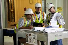 Contractors review plans