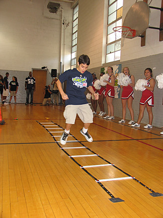 Students compete in the obstacle course as part of the Fuel Up to Play 60 kickoff event in Dallas.