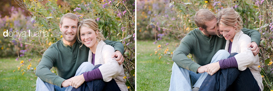 Married couple pose near flowers at St. Olaf College in Minnesota for portraits