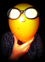 Sunglassio! (rosieissmiling) Tags: orange silly color glasses funny hand think balloon tie ponder chin