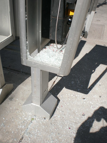 Smashed pay phone booth (3)