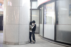 A teenage couple embrace in the heart of Beijing City (thepicturestory) Tags: building love college publicspace hug kiss couple beijing streetphotography highschool teen innocence moment embrace tender teenage puppylove idealism photoshelter apicturestory chinayouth joelboh thepicturestory ourpicturestory