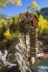 Crystal Mill (Jim Boud) Tags: camera longexposure blue autumn mountain green fall mill leaves yellow canon river eos waterfall leaf colorado stream crystal wideangle filter valley rockymountains aspen dslr digitalrebel oldmill photoart digitalslr firtree artisticphotography superwideangle crystalmill canon1022mm crystalcolorado neutraldensity jimboud t2i jamesboud eos550d kissx4