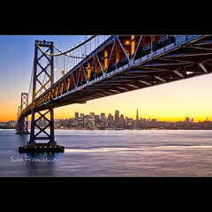 Sunset in San Francisco Skyline under the Bay Bridge (Dominique Palombieri) Tags: sanfrancisco california city bridge sunset usa lens landscape cityscape fav20 baybridge dominique olivier 2010 fav10 palombieri mygallery1