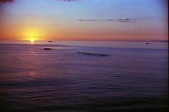 dust-filled sunset (semievilsquirrel) Tags: sunset seascape japan 35mm minoltasrt101 colorfilm fujicolorsuperiaxtra400