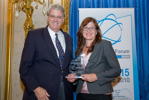 Senator Lundy accepting her award from Phil Noble, founder and chairman of PoliticsOnline, USA