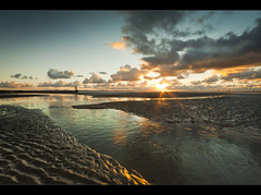 Bed of wonderful water, Sunset on Crosby beach, Explored! (Ianmoran1970) Tags: sunset orange sun colour beach water reflections wonderful boots flare crosby crosbybeach muddyboots ianmora
