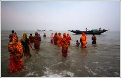 The Sacred Tide [..Dublar Char, Sundarbans, Bangladesh..] (Catch the dream) Tags: ocean souls boats women bath faith religion belief fair fullmoon bathing devotees bangladesh sins purnima radhakrishna bayofbengal bagerhat