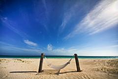 Bahamas Hammock (Nick Mulcock) Tags: red beach sunshine rock canon flickr gallery day angle wide award sigma crop hammock hi bahamas freeport 8mm 16mm grandbahamaisland d60 816 lucayan heach 60d flickraward flickraward5 flickrawardgallery highrockbeach