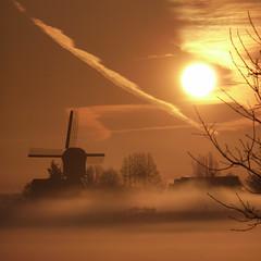 Misty sunrise (Focusje (tammostrijker.photodeck.com)) Tags: morning sun mist holland mill netherlands dutch clouds sunrise