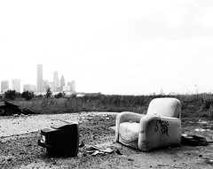 Houston Skyline, from near Elysian, Houston, Texas 0409111253BW (Patrick Feller) Tags: skyline chair emptychair television junk abandoned houston city urban harriscounty texas elysian elysianfields elysianviaduct decay united states north america