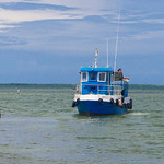 Small fishing boats come and go from Isabela de Sagua thumbnail