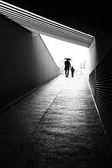 father and son (digital_underground) Tags: speicherstadt hamburg rain umbrella men child blackwhite germany hafencity garage tunnel
