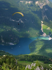 Paragliding along the Alpine mountains and Knigssee (Bn) Tags: lake germany bavaria berchtesgaden topf50 meadows kings fjord hikers paragliding thealps paraglider topf100 topf200 paragliders verticalpanorama rayoflight hanggliders 100faves 50faves 200faves nationalparkberchtesgaden jennerbahn berchtesgadennationalpark alpinemountains jennermountain cloudsinthemountains germanbavarianalps southofgermany schnauamknigssee mountjenner berchtesgadenalps formedbyglaciers nearborderwithaustria jennermountaintop1870m picturesquesetting sheerrockwalls steeplyrisingflanksofmountainsupto2700m hikingtrailsupthesurroundingmountains royalmountainexperience thebreathtakingalpinemountainsoftheknigssee 1874mhigh mountjennercablecar cliffyrocks