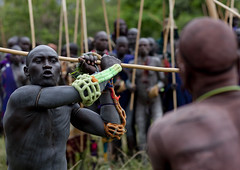 Donga stick fighting in Surma tribe - Ethiopia (Eric Lafforgue) Tags: africa red collier rouge outdoors togetherness necklace fight artistic competition tribal ornament together barefoot violence warrior ritual bodypainting ethiopia tribe ethnic rite protectors ensemble stickfight surma headdress adornment afrique pigments hitting headwear virility headgear tribu omo eastafrica donga padding suri ethiopie traditionalclothes frapper piedsnus 1784 protections rembourrage peinturecorporelle suris nomadicpeople surmatribe surmas virilite habittraditionnel suripeople peuplenomade peoplesoftheomovalley surmapeople peuplesdelavalleedelomo suritribe sagenai