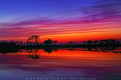 Layers of Clouds (M Atif Saeed) Tags: blue pakistan sunset lake reflection nature water landscape colorful hour lahore abigfave atifsaeed gettyimagespakistanq1