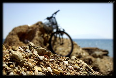 Bike on the Rocks........... (Zopidis Lefteris) Tags: blue sea summer water bicycle rocks hellas greece cycle alexandroupolis allrightsreserved ellada lefteris     alexandroupoli zop      zopidis      photographerzopidislefteris photographerzopidislefterisc c  allphotosarecopyrightedbyzopidislefteris  copyright