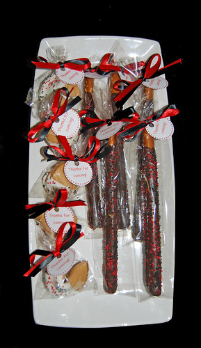 Red and Black Chocolate Dipped Pretzel and Fortune cookie favors for a ladybug party