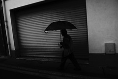 Lourdes (Che-burashka) Tags: travel vacation blackandwhite bw man france lines silhouette wall umbrella places bn lourdes lx3 10hols