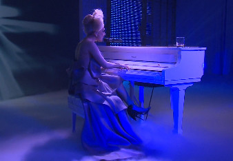 Laday Gaga performs on a Roland digital grand.