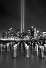 Tribute in Lights. (Vitaliy P.) Tags: world park new york city nyc bridge bw cloud white black building window water monochrome vertical brooklyn river lights 1 pier moving nikon memorial long exposure downtown manhattan district towers 911 twin center spot september east explore gothamist tribute breakers 11th trade financial orientation twc 2010 pier1 explored d80 vitaliyp