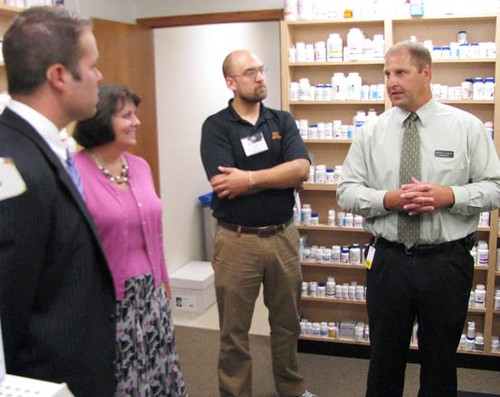 Bryan Hagen, right, of Sterling Drug discusses a new telepharmacy in Adrian, Minn., with Nate Arch from Sen. Al Franken's office, USDA Rural Development State Director Colleen Landkamer and Matt Wohlman from Rep. Tim Walz's office.