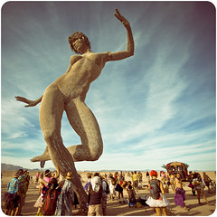 Bliss Dance (tripowski) Tags: sky sculpture woman usa man art festival metal america nikon desert nevada playa blackrockcity burning brc bm 2010 1424 d700 burningman2010 blissdance