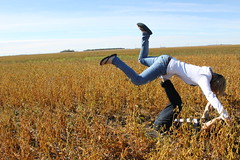 Just having fun! (Jennifer.Galea) Tags: blue autumn boy sky 3 fall love boyfriend girl field hat canon outside photography flying kiss girlfriend couple air bluesky jeans peas haha intheair stripedshirt actionshot hollister warmcolors girlandboy sooc jennifergalea23 jenngalea uglypeas