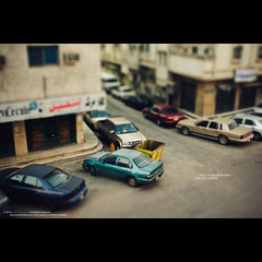 Rise and shine! (Waseef Akhtar) Tags: road street city summer urban color macro building cars tourism facade toy outdoors town miniature focus warm europe quiet view space small middleeast shift mini driveway arabia environment technique riyadh saudiarabia tone selective defocused tiltshift