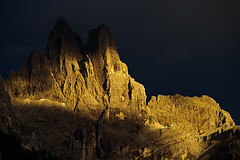 Sass Maor and Cima della Madonna, Pale di San Martino, Dolomites, Italy (Xindaan) Tags: italien blue light sunset shadow summer sky italy orange cliff house mountain mountains nature colors berg yellow rock architecture landscape geotagged evening abend licht nikon scenery europa europe italia colours sonnenuntergang dusk sommer natur htte himmel sigma berge hut architektur blau f56 landschaft stein schatten 70200 dolomites dolomiti d3 alpenglow farben 2010 gebirge dolomite dolomit 70200mm mountainrange telezoom dolomiten 200mm sanmartinodicastrozza gestein alpenglhen 7020028 sigma70200f28exdghsm campitellodifassa trentinoaltoadige paledisanmartino platinumheartaward d3s cimadellamadonna sassmaor rifugioveladellamadonna