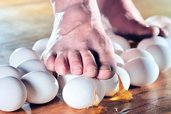 Walking on Eggs (Allison Achauer) Tags: feet broken walking foot smash mess floor egg crack step eggs 365 delicate fragile careful yolk breaking eggshells 85mm14 strobist trod benchmonday