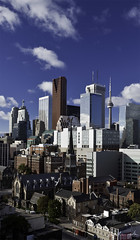 Scraping the Sky (Don Komarechka) Tags: city blue sky toronto ontario canada rooftop skyline skyscraper canon cntower stmichaels ef24105mmf4lisusm canoneos5dmarkii tup2010