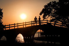 Sunset on the Bridge (Sky Noir) Tags: bridge sunset vacation sky orange art silhouette yellow architecture club gold couple footbridge north sound carolina nouveau outerbanks corolla obx currituck whalehead skynoir yahoo:yourpictures=light